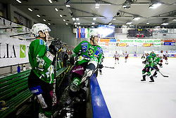 Bostjan Groznik of Tilia Olimpija and Burke Henry of Tilia Olimpija at 38th Round of EBEL league  ice hockey match between HDD Tilia Olimpija Ljubljana and HK Acroni Jesenice, on January 1, 2010, in Arena Tivoli, Ljubljana, Slovenia. (Photo by Vid Ponikvar / Sportida)