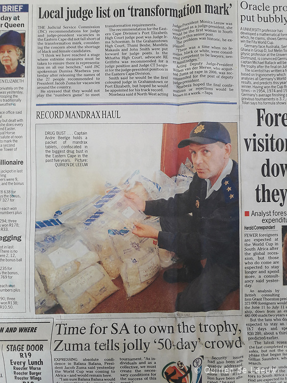 """""""Captain Andre Beetge holds a packet of mandrax tablets, confiscated in the biggest drug bust in the Eastern Cape in the past five years."""""""