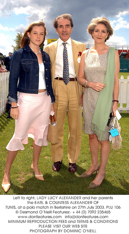 Left to right, LADY LUCY ALEXANDER and her parents the EARL & COUNTESS ALEXANDER OF TUNIS, at a polo match in Berkshire on 27th July 2003.PLU 106