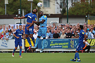 AFC Wimbledon midfielder Tom Soares (19) winning header during the EFL Sky Bet League 1 match between AFC Wimbledon and Coventry City at the Cherry Red Records Stadium, Kingston, England on 11 August 2018.