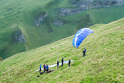 A para gliders prepear to fly from the hills around Mam Tor in the Hope Valley <br />  11 October 2015<br />   Image © Paul David Drabble <br />   www.pauldaviddrabble.co.uk