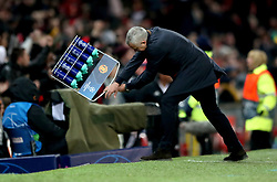 Manchester United manager Jose Mourinho throws a rack of water bottles after Manchester United's Marouane Fellaini scores his side's first goal of the game
