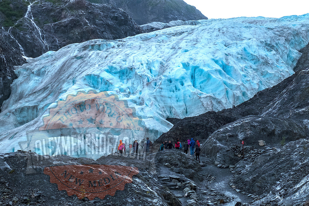 Visitors are seen as they hike up to the Exit Glacier at the Kenai Fjords National Park in Seward, Alaska, on Thursday, August 4, 2016. (Alex Menendez via AP)