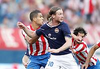 Atletico de Madrid's Alvaro Dominguez against Stromsgodset's Jo Inge Berget during UEFA Europa League third qualifying round match. July 28, 2011. (ALTERPHOTOS/Alvaro Hernandez)