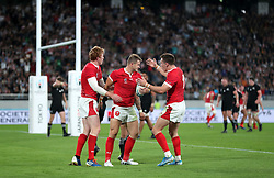 Wales' Hallam Amos (centre) celebrates scoring his sides first try during the 2019 Rugby World Cup bronze final match at Tokyo Stadium.
