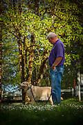 USA, Oregon, Scio, Larwood Wayside, a man and his dog. MR, PR