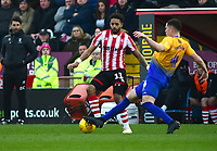 Lincoln City's Bruno Andrade vies for possession with  Mansfield Town's Matt Preston<br /> <br /> Photographer Andrew Vaughan/CameraSport<br /> <br /> The EFL Sky Bet League Two - Lincoln City v Mansfield Town - Saturday 24th November 2018 - Sincil Bank - Lincoln<br /> <br /> World Copyright © 2018 CameraSport. All rights reserved. 43 Linden Ave. Countesthorpe. Leicester. England. LE8 5PG - Tel: +44 (0) 116 277 4147 - admin@camerasport.com - www.camerasport.com