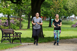 © Licensed to London News Pictures. 28/05/2021. London, UK. Joggers running on a warm day in Finsbury Park, north London. According to the Met Office, a high of 24 degrees celsius is forecast for the bank holiday weekend, after weeks of rain in the capital. Photo credit: Dinendra Haria/LNP