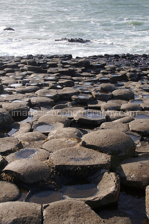 The Giants Causeway geological phenomenon with hexagonal columns formed by lava cooling during Tertiary period in Antrim Northern Ireland