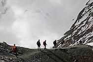 Trekking group descending an easier ridge just after a successful summit on Stok Kangri, 6100+ metres high, Ladakh