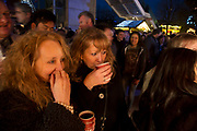 Friends hanging out at the Christmas market on the Southbank. Enjoying some mulled wine. The South Bank is a significant arts and entertainment district, and home to an endless list of activities for Londoners, visitors and tourists alike.