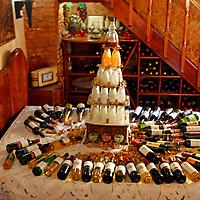 Central America, Cuba, Trinidad. Display of wine bottles top a bed at Sol Ananda, Trinidad, Cuba