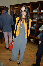 DEMI MOORE at a private view of photographs by Gray Malin 'Beaches' held at Huntsman, 11Savile Row, London on 20th June 2016.