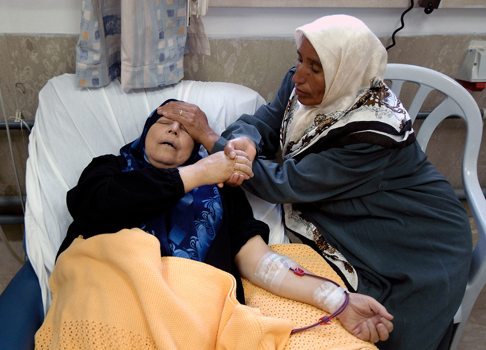 A Palestinian woman, comforted by her sister, receives kidney dialysis treatment at East Jerusalem's Augusta Victoria Hospital, run by the Lutheran World Federation.