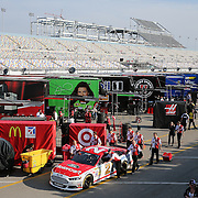 Crew members push the #21 of Trevor Bayne to the inspections area prior to the 56th Annual NASCAR Daytona 500 race at Daytona International Speedway on Sunday, February 23, 2014 in Daytona Beach, Florida.  (AP Photo/Alex Menendez)
