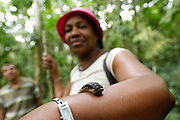Ecuador, May 6 2010: Lorna Brooks poses with a millipede on her left arm. Copyright 2010 Peter Horrell