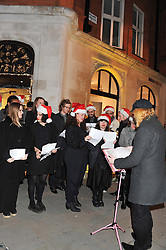 Carol singers at a party to celebrate the launch of a limited edition shoe The Chambord in celebration of Nicholas Kirkwood's partnership with Chambord black raspberry liqueur, held at the Nicholas Kirkwood Boutique, 5 Mount Street, London on 12th December 2012.
