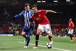 Brighton & Hove Albion's Pascal Gross (left) and Manchester United's Nemanja Matic battle for the ball during the Emirates FA Cup, quarter final match at Old Trafford, Manchester.