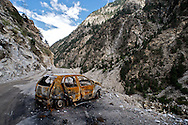 A burned out car sits on the Himalayan Highway a few hours outside of Reckong Peo in Himachal Pradesh, India