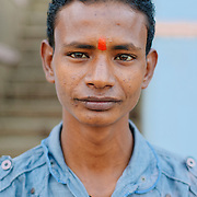 Portrait of candle seller at Assi ghat