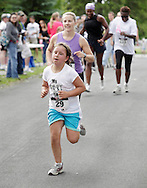 Middletown, New York - Grace Bonitz, 9, of Montgomery heads for the finish line in the 15th annual Ruthie Dino Marshall 5K Run and Fun Walk hosted by the Middletown YMCA on Sunday, June 5, 2011. ©Tom Bushey / The Image Works