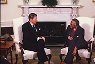Washington, DC 1984/12/07   President Ronald Reagan  meets with Bishop Desmond Tutu in the Oval Office. <br /><br /><br />Photo by Dennis Brack