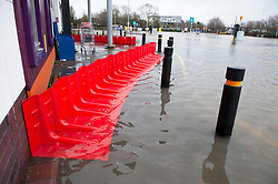 ©Licensed to London News Pictures 22/12/2019. <br /> Tonbridge ,UK. Sainburys flood defences. Heavy rain over night has caused more Christmas flooding in Kent.  Christmas shoppers in Tonbridge, Kent are facing severe disruption in the town centre with two car parks, roads and pathways all flooded and out of action as the River Medway bursts its banks. Photo credit: Grant Falvey/LNP