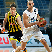 Efes Pilsen's Igor RAKOCEVIC (R) and Fenerbahce Ulker's Marko TOMAS (L) during their Turkish Basketball league derby match Efes Pilsen between Fenerbahce Ulker at the Sinan Erdem Arena in Istanbul Turkey on Sunday 24 April 2011. Photo by TURKPIX