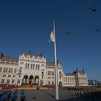 Helicopters perform a flyover as army officers graduating from the National University of Public Service take their oath of office during a ceremony in front of the Parliament on Hungarian national holiday in Budapest, Hungary  on Aug. 20, 2020. ATTILA VOLGYI