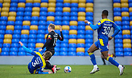 Dániel Csóka of AFC Wimbledon tackles Lincoln City Midfielder Anthony Scully (11) during the EFL Sky Bet League 1 match between AFC Wimbledon and Lincoln City at Plough Lane, London, United Kingdom on 2 January 2021.