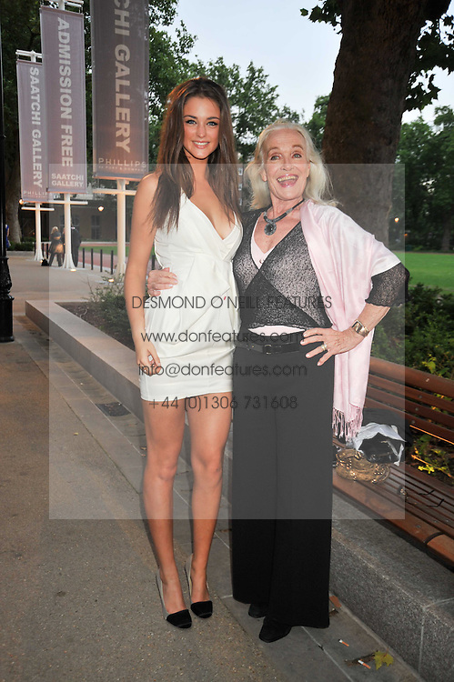 Left to right, LAUREN BUDD (Model name Violet Budd) and SHIRLEY EATON at an exhibition of photographic portraits by Bryan Adams entitled 'Hear The World' at The Saatchi Gallery, King's Road, London on 21st July 2009.