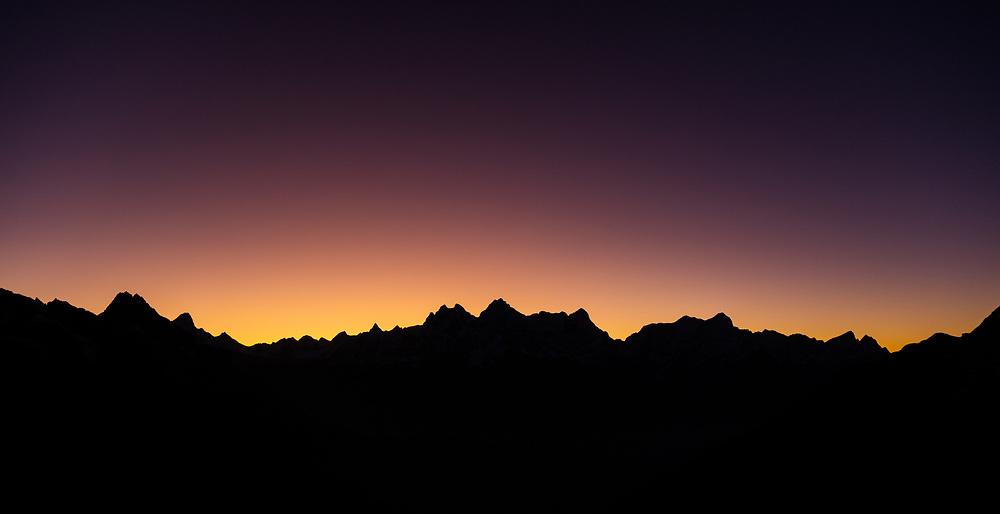 The sun rises behind the peaks of Ama Dablam, Kantega and Thamsherku in Nepal