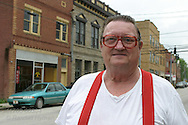 Man in red suspenders poses in downtown Salyersville, Kentucky