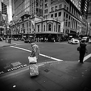 Old lady waiting on a street corner in Sydney, Australia