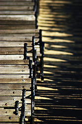 Row of outdoor benches at a concert venue