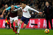 Son Heung-min of Tottenham Hotspur (R) fends off Pablo Zabaleta of West Ham United (L). Premier league match, Tottenham Hotspur v West Ham United at Wembley Stadium in London on Thursday  4th January 2018.<br /> pic by Steffan Bowen, Andrew Orchard sports photography.