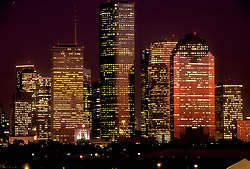 Buildings of Houston, Texas skyline lit up at night.