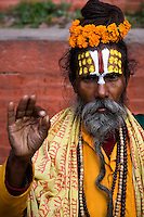 In Hinduism, a sadhu is a common term for an ascetic or yogi who has given up pursuit of the first three Hindu goals of life: kama (enjoyment), artha (practical objectives), and dharma (duty). The sadhu is dedicated to achieving the fourth and final Hindu goal of life - liberation through meditation. Sadhus usually wear ochre colored clothing, symbolizing renunciation.