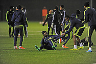 Swansea's Marvin Emnes (on ground) during Swansea city FC team training in Landore, Swansea, South Wales on Wed 19th Feb 2014. the team are training ahead of tomorrow's UEFA Europa league match against Napoli.<br /> pic by Phil Rees, Andrew Orchard sports photography.