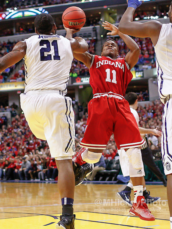 INDIANAPOLIS, IN - DECEMBER  20: Roosevelt Jones #21 of the Butler Bulldogs fouls Yogi Ferrell #11 of the Indiana Hoosiers during the shot at Bankers Life Fieldhouse on December 20, 2014 in Indianapolis, Indiana. Indiana defeated Butler 82-73. (Photo by Michael Hickey/Getty Images) *** Local Caption *** Roosevelt Jones; Yogi Ferrell