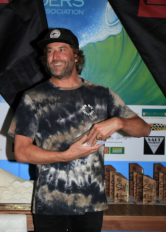 Taranaki surfer Jarred Hancox (41), has claimed his first win at national level in twenty years.  The committed goofy foot surfer won the Emerson's South Island Surfing Championships held at St Clair Beach, Dunedin over Easter Weekend.<br /> <br /> Hancox joined Gisborne's Saffi Vette who won her second event of the year in the Open Women's Division after winning the National Championships at Piha in January.<br /> The final day of the event was held in solid 1.5m waves with strong northwest winds making life challenging for many of the finalists.