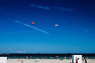 People engaged in a wide variety of beach activities. WATERMARKS WILL NOT APPEAR ON PRINTS OR LICENSED IMAGES.
