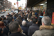 very crowded sidewalk on Canal street in China Town New York City