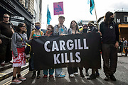 Animal rights activists from Animal Rebellion stand behind a banner outside Smithfield Meat Market at the end of a National Animal Rights March on 28th August 2021 in London, United Kingdom. Animal Rebellion, an offshoot of Extinction Rebellion, organised the march for the sixth day of Extinction Rebellions protests in London, with stops at Smithfield meat market, Unilever which owns brands that sell dairy products and use palm oil, Cargill which is one of the worlds largest meat processors and the Marine Stewardship Council.