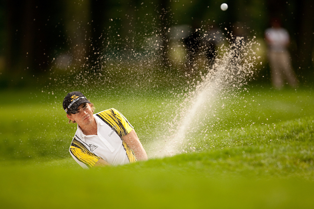 FARMINGDALE, NY - JUNE 20:  Camilo Villegas hits his shot out of a bunker during the continuation of the second round of the 109th U.S. Open Championship on the Black Course at Bethpage State Park on Saturday, June 20, 2009. (Photograph by Darren Carroll) *** Local Caption *** Camilo Villegas