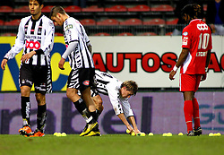 12.03.2011, Stade du Pays, Charleroi , BEL, JL,  Sporting Charleroi vs Standard Liège, im Bild Charleroi 's players and  Standard 's Meme Tchite clean the pitch after Charleroi supporters trowed tennis balls during Jupiler Pro League Season 2010 - 2011 soccer match R Charleroi SC and  Standard. Saterday Mar. 12, 2011.  EXPA Pictures © 2011, PhotoCredit: EXPA/ nph/  Alain Sprimont       ****** out of GER / SWE / CRO  / BEL ******