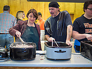 28 NOVEMBER 2019 - DES MOINES, IOWA: US Senator AMY KLOBUCHAR (D-MN), left, talks to KEVIN SHERIFF, a volunteer on the serving line at the South Des Moines Community Center. Sen Klobuchar served Thanksgiving lunches to people at the center. Sen. Klobuchar is campaigning to be the Democratic nominee for the US Presidency. Iowa holds the first selection event of the Presidential election cycle. The Iowa caucuses are Feb. 3, 2020.             PHOTO BY JACK KURTZ