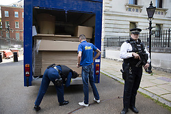 © Licensed to London News Pictures. 12/07/2016. London, UK. A removals van is searched as it drives in the back entrance of Downing Street. Theresa May will become Prime Minister tomorrow after the last candidate for leadership of the Conservative party stood down. Photo credit: Peter Macdiarmid/LNP