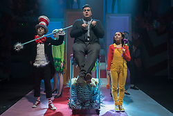 """© Licensed to London News Pictures. 23/11/2018. LONDON, UK. (L to R) Mark Pickering as Cat in the Hat, Scott Paige as Horton the Elephant and Anna Barnes as JoJo perform during the photocall for Immersion Theatre's performance of """"Seussical the Musical"""" at Southwark Playhouse.  Shows take place 22 November to 29 December 2018.  Directed by James Tobias, the fantastical world of Dr. Seuss is brought to life in a musical co-conceived by Monty Python's Eric Idle.  Photo credit: Stephen Chung/LNP"""