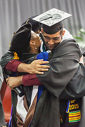 Jae A. Knight gets hug from Provost  Dr. Camille A. McKayle.  Fifty-first annual University of the Virgin Islands  Commencement Exercises.  UVI Sports & Fitness Center.  St. Thomas, VI.  14 May 2015.  © Aisha-Zakiya Boyd .  Fifty-first annual University of the Virgin Islands  Commencement Exercises.  UVI Sports & Fitness Center.  St. Thomas, VI.  14 May 2015.  © Aisha-Zakiya Boyd